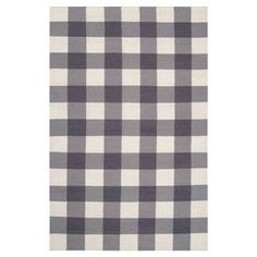 Hand-woven plaid wool rug. Reversible.  Product: RugConstruction Material: 100% WoolColor: Winter white, gray and purple sageFeatures:  Hand-wovenMade in India Note: Please be aware that actual colors may vary from those shown on your screen. Accent rugs may also not show the entire pattern that the corresponding area rugs have.Cleaning and Care: Blot stains