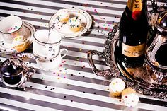 coffee to sober up and more champagne to stay festive:) stripes + confetti   #FEELBEAUTIFUL #WHBM