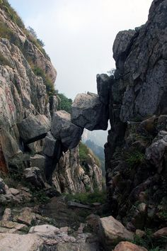 Yellow Mountains in China. One of the mountains Mount Tai has something that they call the Immortal Bridge.