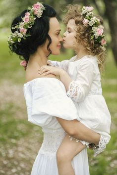 Love the flowers in their hair SO going to do this with Ava & Emma