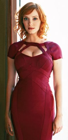 Christina Hendricks in a beautiful dress that I could never wear because I have completely the wrong figure.