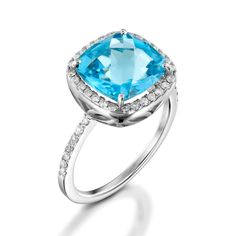 This isacarved claw andenclosed pave as halo, including paves cluster on the band ring. Set with a solitaire gemstone Blue Topazand diamonds. The ring is set with a single gemstone, a natural Blue Topaz, cushion checkers board cut, 12 mm, color is Sky Blue, clarity is eye clean or better, average carat weight is 4.75 carat. The diamonds set in the ring paves are 42 round brilliant cut, white color in ranges of F-G, clarity is eye clean in ranges of VS-SI, average carat weight is 0.35…