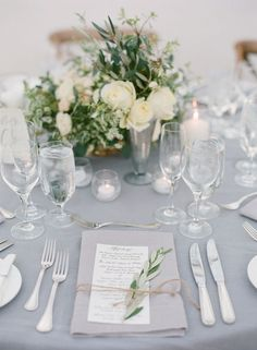 white and grey wedding table decor // grey linens, winter wedding, white and greenery centerpieces, place setting