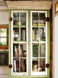A pair of eight-pane windows that serve as doors, the books are arranged on three deep shelves. A piece of crown molding finishes the bookcase in style. Painted Furniture, Diy Furniture, Furniture Design, Shed Windows, Shed Organization, Organizing, Deep Shelves, Old Doors, Cottage Style