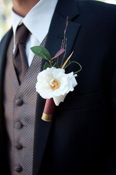 Ideas for boutonniere alternatives perfect for reflecting the grooms interests, hobbies or personalities. Non floral wedding boutonniere ideas. Boutonnieres, Shotgun Shell Boutonniere, Bullet Boutonniere, Rose Boutonniere, Wedding Bouquets, Wedding Favors, Wedding Flowers, Wedding Decorations, Wedding Dresses