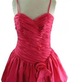 """80s Rose Pink Party Dress - close up  80s rose pink party dress .Elaborate and elegant ,with stunning detail,this 80s rose pink party dress features a rose pink satinized finish, shallow V neckline,shoulder straps and diagonally pleated bodice.With a peplum skirt with an appliquéd flower #vintagebloggers #vintagefashion #vintage #retro #vintageclothing #80s #1980s #vintagedress    <link rel=""""canonical"""" href=""""http://www.blue17.co.uk/>"""