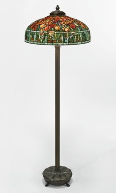 "Tiffany Studios -  ""TULIP"" FLOOR LAMP -    with a ""Chased Pod"" Junior floor base shade impressed TIFFANY STUDIOS NEW YORK 1548 base impressed Tiffany Studios/NEW YORK/379 leaded glass and patinated bronze, 63 1/2  in. (161.3 cm) high 22 1/2  in. (57.2 cm) diameter of shade circa 1905"