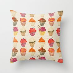 Pillow with colorful dessert cupcakes.