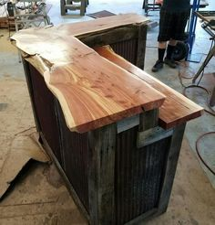 Barnwood bar with live edge Cedar tops and barn tin sides