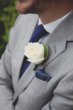 Instead of polka dot tie, try the hankerchief only. And stick with plain navy blue ties. Add red rose instead of white rose.