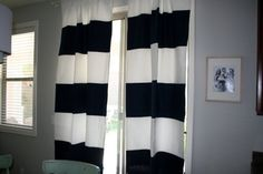 Navy and white striped curtains - will complete the nursery!