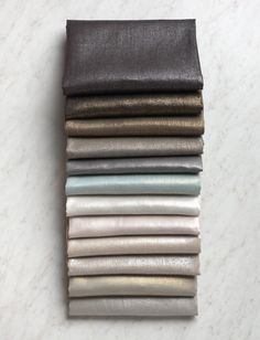 Mineral Linen Bundle, 12 Fat Quarters - Purl Soho's Mineral Linen starts with linen, raw and pure, and finishes with a metallic sheen, sparkling and beautiful. It arrives smooth and crisp, but once machine laundered, it gets softer and more textured. Iron out the wrinkles if you want, or keep them