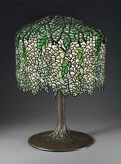 A WISTERIA LEADED GLASS AND BRONZE TABLE LAMP, CIRCA 1910
