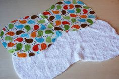 terry cloth burp rags- this pattern is a similar shape to the one my mom has- I like the terry cloth idea!