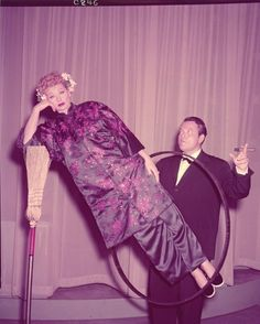 "Orson Welles performing the ""Broomstick Suspension"" magic trick with Lucille Ball during the filming of the I Love Lucy episode, ""Lucy Meets Orson Welles"" (1956)"
