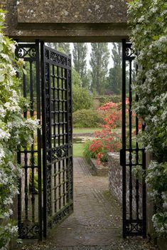 The ornamental wrought iron gate between the Rose Garden and Lily Garden at Barrington Court, Somerset