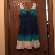 Sparkly Summer Dress Beautiful blue and turquoise fading into each other.  Sequins.  V-neck.  Cute ties in back.  Side zipper.  Lining.  Just a little wrinkled from living in my closet. Guess Dresses