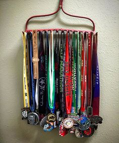 How do you display your race medals? I gave new life to an antique garden rake…