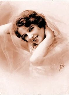 """Olive Thomas (1894 - 1920) Silent film actress & Ziegfield girl. She was one of the first """"Flappers"""" in Hollywood. Remembered today for being married to Jack Pickford and dying under very mysterious circumstances at  25 years of age, after accidentally consuming mercury bichloride. Thomas' death has been cited as one of the first heavily publicized Hollywood scandals."""