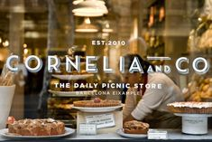 Cornelia & co, Barcelona. Love the signage and the picnic concept! Storefront Signage, Window Signage, Retail Signage, Wayfinding Signage, Signage Design, Branding Design, Design Café, Cafe Design, Store Design