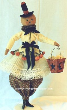 """""""Trick or treat"""" Created by me and dressed in antique fabric. love the little """"pumpkins""""."""