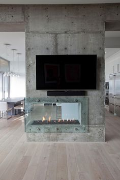 Glass Fireplace in a Concrete Wall - Burnaby Residence by Tanya Schoenroth Design