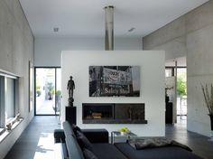 Wohnraum  mit Kamin (von PaulBretz Architectes)