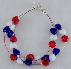 """Patriotic"" handmade beaded bracelet by Moon Goddess Jewelry....3-strands of Czech heart-shaped pressed glass beads in ""Red"", ""White"", & ""Blue"" on colored jewelry wire.  http://www.moongoddessjewelry.com"