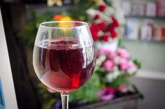 No we haven't been drinking on the job this morning, this is actually a candle. Come in and you'll find we have more than just flowers. Red Wine, Drinking, Alcoholic Drinks, Candles, Glass, Flowers, Food, Beverage, Drink