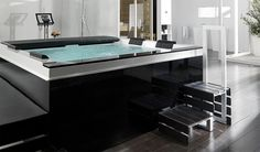 http://www.minimalisti.com/wp-content/uploads/2011/11/Modern-bathroom-with-jacuzzi.jpg