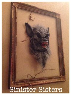 Make your own framed horror art by framing a costume mask. Sinister Sisters and Danali Home.