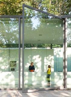 Large pivoting glass door.