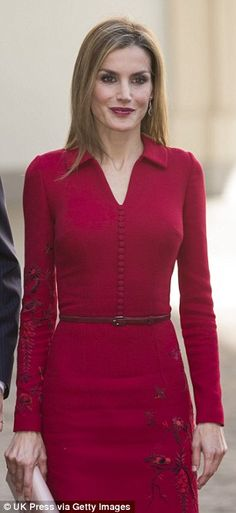 Keeping it simple: Queen Letizia was chic in a fitted crimson dress for her arrival in the Netherlands today, 15 October 2014.
