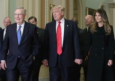 Senate Majority Leader Mitch McConnell (L), walks with President-elect Donald Trump, his wife Melania Trump, and Vice President-elect Mike Pence (not seen) at the U.S. Capitol for a meeting November 10, 2016 in Washington, DC. Earlier in the day president-elect Trump met with U.S. President Barack Obama at the White House.