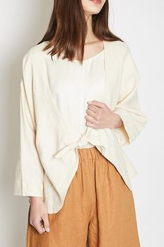 Lauren Winter Knot Blazer in cream linen is a minimalist jacket with dolman sleeve and front tie closure. Unlined, hits at hip. A great piece to wear in the ...