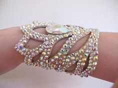 Beautiful handmade bracelet with AB rhinestones for belly dance and ballroom performances. Over than 500 of high quality AB rhinestones are used which makes this dance jewelry really sparkling. Base for this bracelet is imitation leather and velcro.  The bracelet is flexible, but