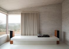 John Pawson has completed the seventh property in Alain de Botton's Living Architecture series: a Welsh valley retreat with a dark skin and a pale interior