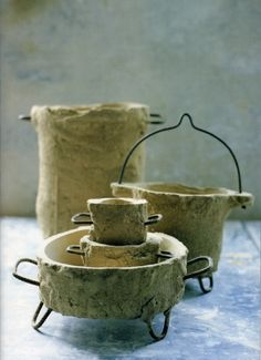 "sander lucas, lucasenlucas.com. ""archaeologic find"" cups, saucers, pitchers, made with concrete and reinforcements"