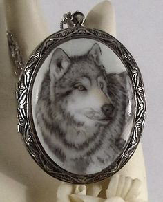 Awesome Grey Wolf Cameo Silver  Locket Necklace. $59.95, via Etsy.