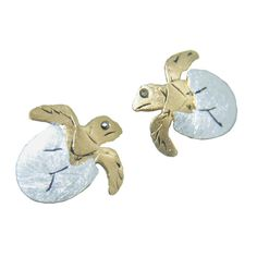 Hand-made sterling silver hatching turtle post earrings. The egg portion of the pendant is rhodium plated and sand-blasted while the hatching turtle is plated with yellow gold. The etched parts of the earring are plated with black rhodium and marcasite eyes