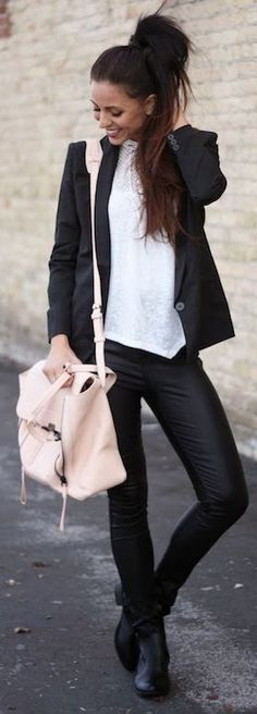 Black & white outfit, high collar and pony.