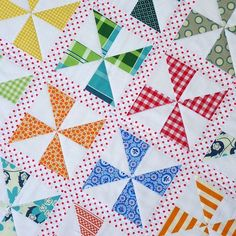 The use of the polka dot as the background fabric on this pinwheel quilt is adorable! From www.redpepperquilts.com