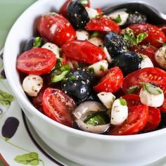 Tomato, Olive, and Mozzarella Salad with Basil Vinaigrette Recipe Salads with black olives, cherry tomatoes, fresh mozzarella, vinaigrette dressing, fresh basil leaves, ground black pepper, salt