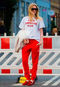 In Adidas pants and Gucci shoes. Photographed by Style Du Monde at Copenhagen Fashion Week. xmas gift: red addidas pants, white shirt with blue dala horse reads vastergotland. Adidas Hose, Adidas Pants, Athleisure Trend, Oversized Shirt Outfit, Style Casual, My Style, Looks Adidas, Sport Fashion, Womens Fashion
