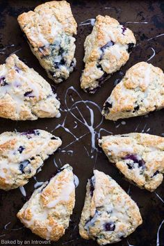 Fluffy blueberry buttermilk scones studded with fresh blueberries and topped with a sweet glaze.