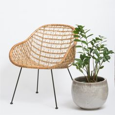 With a comfortable open weave design and a modern scoop shape, this rattan and steel chair is universally appealing. Cluster several in conversation areas or feature one in an airy reading nook. Our r