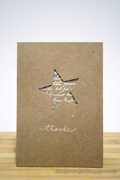 negative space die cut star backed with white script embossed on kraft .this cud also be a christmas card