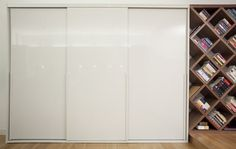 Fitted #wardrobes with high gloss sliding doors and matching L shaped handles