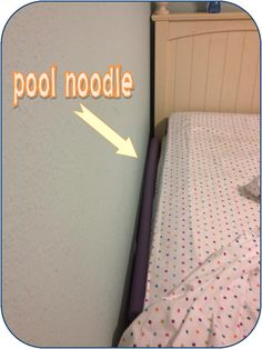 use a pool noodle to block the gap between bed and wall and keep toys, books, cups and pacifiers from falling out of reach under the bed