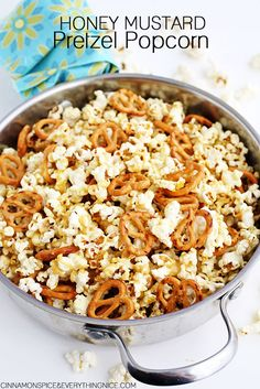 Fresh popped popcorn and pretzels drizzled in a sweet and tangy honey mustard. With only three ingredients it's a cinch to make: butter, honey and Dijon mustard. Melt the three together, drizzle, toss, drizzle, toss. . . etc. . . Then crunch, munch, crunch, munch, munch, munch. . .crunch. . . You know how popcorn …